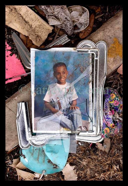 10th December, 2005. Aftermath of Hurricane Katrina, New Orleans, Louisiana. A broken photo frame lies in the front porch of a house in Gentilly where sadly a victim of the storm perished.