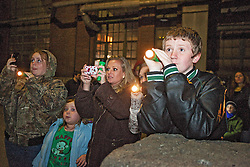 Houston FInnell, right, of Frankfort looks into an abandoned building with his cousin Lesha Whitson, left, sister Shayla Long and mother Stephanie Long during the first of what will be regular ghost tours at the oldest distilling site in the U.S., Thursday, Nov. 17, 2011 at Buffalo Trace Distillery  in Frankfort. Photo by Jonathan Palmer