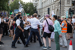 London, UK. 24 July, 2019. Police officers, accompanied by Tobias Ellwood MP, try to move protesters from antifascist and LGBT+ groups out of the road in Parliament Square during a protest against Boris Johnson's appointment as Prime Minister following his election as leader of the Conservative Party by its members. The protest was named after a lyric in a song by rapper Stormzy recently sung by thousands of festival goers at Glastonbury. Credit: Mark Kerrison/Alamy Live News
