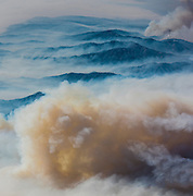 Ocher plumes of smoke rise over a particularly active section of the fire. ©2016 Sivani Babu