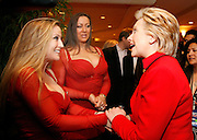 US Democratic presidential candidate Sen. Hillary Clinton (D-NY), greets cocktail waitresses at the Mandalay Bay hotel and casino on caucus day in Las Vegas January 19, 2008.  REUTERS/Rick Wilking  (UNITED STATES)  US PRESIDENTIAL ELECTION CAMPAIGN 2008 (USA)
