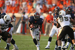 Virginia running back Cedric Peerman (37) runs through a hole against Wyoming.  The Virginia Cavaliers defeated the Wyoming Broncos 13-12 in overtime on September 9, 2006 at Scott Stadium in Charlottesville, VA.