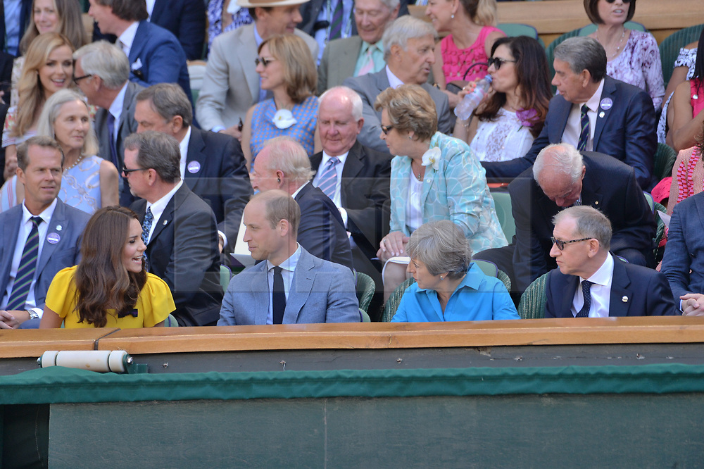 © Licensed to London News Pictures. 15/07/2018. London, UK. HRH The Duke of Cambridge. HRH The Duchess of Cambridge, British prime minister Theresa May and Phillip May watch center court tennis in the royal box on the second day of the Wimbledon Tennis Championships 2018 held at the All England Lawn Tennis and Croquet Club. Photo credit: Ray Tang/LNP