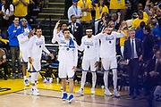 The Golden State Warriors bench celebrates a basket against the Cleveland Cavaliers during Game 1 of the NBA Finals at Oracle Arena in Oakland, Calif., on June 1, 2017. (Stan Olszewski/Special to S.F. Examiner)