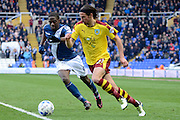 Burnley midfielder George Boyd takes on Birmingham City striker Clayton Donaldson during the Sky Bet Championship match between Birmingham City and Burnley at St Andrews, Birmingham, England on 16 April 2016. Photo by Alan Franklin.