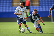 Kaiyne Woolery (Bolton Wanderers) is pulled back by the shirt and shorts during the Pre-Season Friendly match between Bolton Wanderers and Preston North End at the Macron Stadium, Bolton, England on 30 July 2016. Photo by Mark P Doherty.