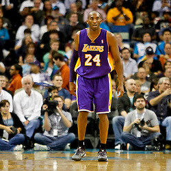 Dec 5, 2012; New Orleans, LA, USA; Los Angeles Lakers shooting guard Kobe Bryant (24) against the New Orleans Hornets during the first half of a game at the New Orleans Arena.  Mandatory Credit: Derick E. Hingle-USA TODAY Sports