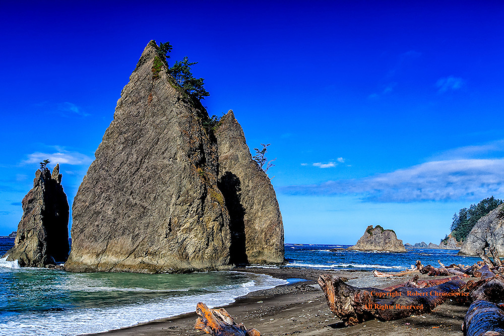 Pacific Sentinel: Another glorious morning on Rialto Beach and the jagged rocky sentinels rise from the Pacific Ocean as they guard the deserted black sand beach, Washington USA.