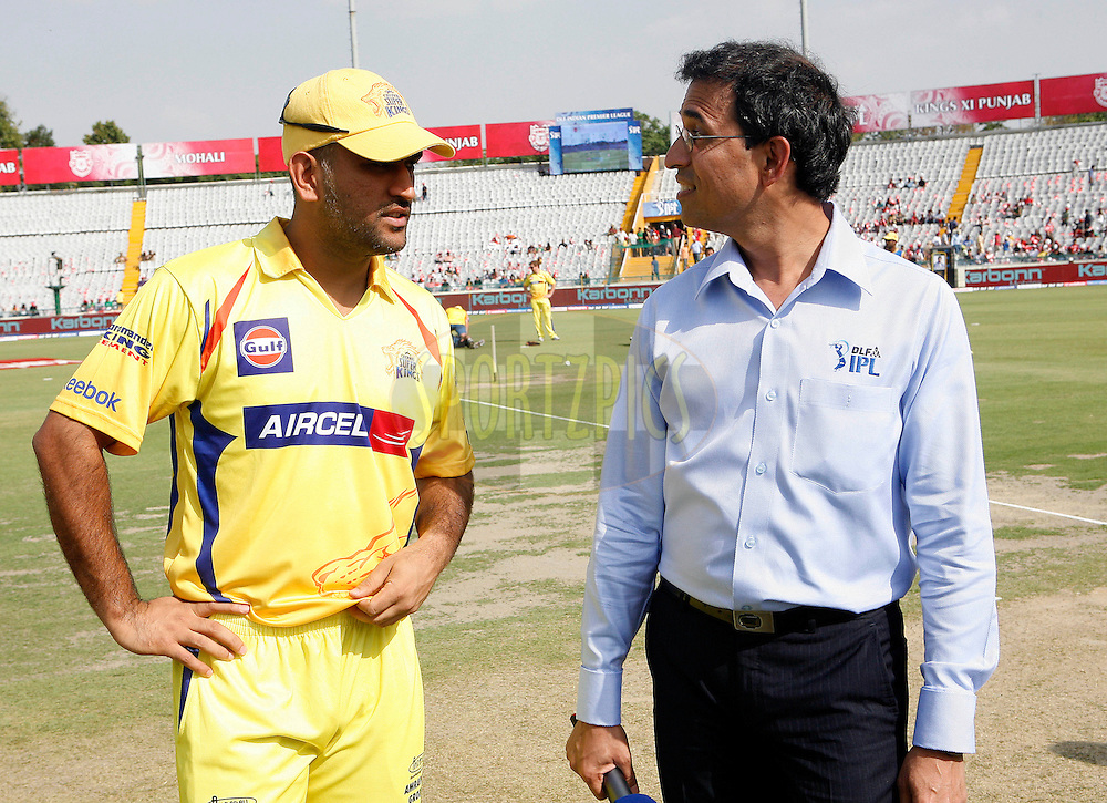 Chennai Super Kings Captain Mahender Singh Dhoni (L) with commentator Harsha Bhogle before the match 9 of the Indian Premier League ( IPL ) Season 4 between the Kings XI Punjab and the Chennai Super Kings held at the PCA stadium in Mohali, Chandigarh, India on the 13th April 2011..Photo by Money Sharma/BCCI/SPORTZPICS