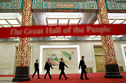 epa06270809 Tuo Zhen (R), spokesperson for the 19th National Congress of the Communist Party of China (CPC) and other officials arrive for a press conference at the Great Hall of the People (GHOP) in Beijing, China, 17 October 2017. The five-yearly 19th National Congress of the Communist Party of China (CPC) will begin on 18 October.  EPA-EFE/HOW HWEE YOUNG