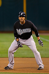 June 28, 2011; Oakland, CA, USA; Florida Marlins second baseman Omar Infante (13) leads off first base against the Oakland Athletics during the first inning at the O.co Coliseum.  Oakland defeated Florida 1-0.