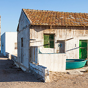 A vacation beach house and the Las Salinas Church in the town of Cabo de Gata, Almeria, Spain.