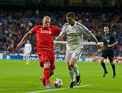 MADRID, SPAIN - Tuesday, November 4, 2014: Liverpool's Martin Skrtel in action against Real Madrid's Cristiano Ronaldo during the UEFA Champions League Group B match at the Estadio Santiago Bernabeu. (Pic by David Rawcliffe/Propaganda)