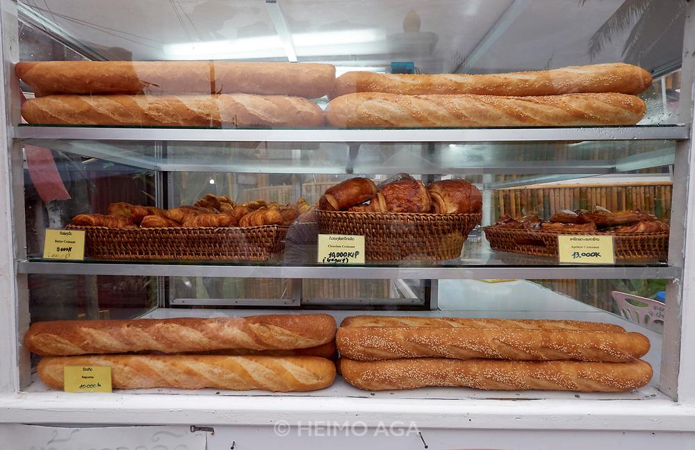 Laos. Luang Prabang. Morning market. French baguettes.