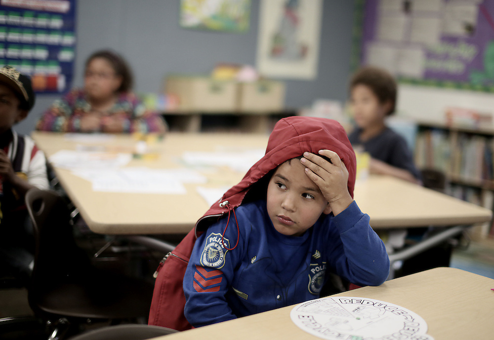 An elementary school student listens during class at the Monarch School in San Diego, CA on Friday, May 15, 2015.  The Monarch School is the largest elementary through High School facility that caters to students that are homeless or are have associations with homelessness.(Photo by Sandy Huffaker for The Atlantic)