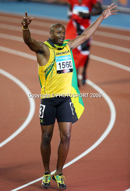 Jamaican athlete Asafa Powell (JAM) celebrates after winning the Men's 100M sprint on Day 5 of the XVIII Commonwealth Games at the MCG, Melbourne, Australia on Monday 20 March, 2006. Photo: Hannah Johnston/PHOTOSPORT<br /><br />150695 celebration celebrating jamaica