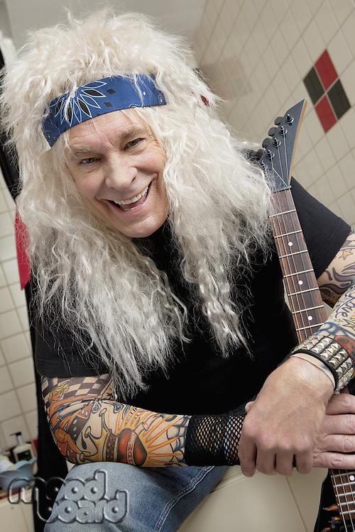 Portrait of hippie guitarist laughing