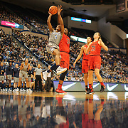 HARTFORD, CONNECTICUT- NOVEMBER 19: Crystal Dangerfield #5 of the Connecticut Huskies drives to the basket defended by Brianna Fraser #34 of the Maryland Terrapins during the the UConn Huskies Vs Maryland Terrapins, NCAA Women's Basketball game at the XL Center, Hartford, Connecticut. November 19th, 2017 (Photo by Tim Clayton/Corbis via Getty Images)