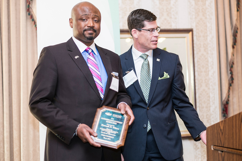 Kenneth N. Wilson, left, and Michael Adelman with Wilson's Outstanding State Government Alumnus Award during the Ohio University State Government Alumni Luncheon on Tuesday, May 5, 2015.  Photo by Ohio University  /  Rob Hardin