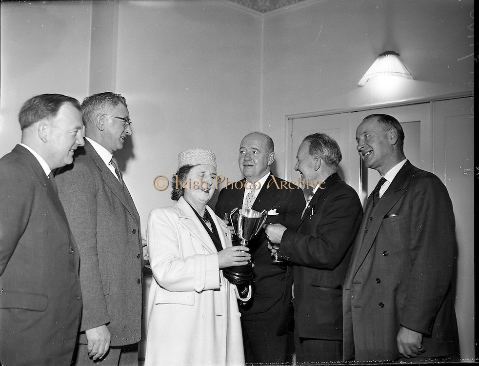 Smithwick Drama Cup Presented to An t-Oireachtas.1960..27.01.1960..01.27.1960..27th January 1960...Mr Walter A Smithwick ,Managing Director, Smithwick and Sons Ltd, Kilkenny,presented a trophy for the All Ireland Drama Festival of An tOireachtas to  Aindrias Ó Muimhneachain, Chairman of An tOireachtas. The cup will be awarded to the Gaelic Drama Group gaining the highest aggregate marks for production and presentation during the festival...Image shows (L-R) Mr Donnachadh Ó Sulleabhain, Secretary, An tOireachtas, Aindrias Ó Muimhneachain, Chairman of An tOireachtas, Ms Siun Ni Mhurchadha, Mr Walter A Smithwick ,Managing Director, Smithwick and Sons Ltd, Mr Seamus Ó Talamhain, Treasurer, An tOireachtas and Mr Vincent McAllister, manager, Dublin Depot, Smithwick and Sons Ltd at the formal presentation.