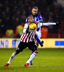 Leon Clarke of Sheffield United challenges Michael Hector of Sheffield Wednesday - Mandatory by-line: Robbie Stephenson/JMP - 09/11/2018 - FOOTBALL - Bramall Lane - Sheffield, England - Sheffield United v Sheffield Wednesday - Sky Bet Championship