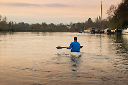 Richmond, London, February 17th 2016. A canoeist paddles into the soft early morning light as dawn breaks over the River Thames. <br /> ///FOR LICENCING CONTACT: paul@pauldaveycreative.co.uk TEL:+44 (0) 7966 016 296 or +44 (0) 20 8969 6875. &copy;2015 Paul R Davey. All rights reserved.