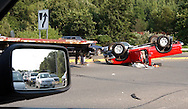 An overturned pick-up truck lays in the street just off the exit ramp to route seven in danbury on thursday afternoon.  the traffic was backed up for miles behind it as can be seen in the photographers rear view mirror.  massive blackouts hit the area causing traffic pandemonium as street lights failed to work