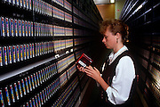 "An employee with 1990s technology at the European Centre for Medium-Range Weather Forecasts (ECMWF), Reading, UK. ECMWF is an international organisation supported by 31 States, its role is ""to provide monthly and seasonal-to-interannual forecasts; to deliver real-time analyses and forecasts of atmospheric composition; to carry out climate monitoring through regular re-analyses of the Earth-system and to contribute towards the optimization of the Global Observing System."" with"