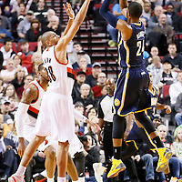 02 December 2013: Indiana Pacers small forward Paul George (24) takes a jumpshot over Portland Trail Blazers small forward Nicolas Batum (88) during the Portland Trail Blazers 106-102 victory over the Indiana Pacers at the Moda Center, Portland, Oregon, USA.