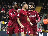 Football - 2018 / 2019 Premier League - Fulham vs. Liverpool<br /> <br /> James Milner of Liverpool celebrates scoring the winning goal from the penalty Spot, with Mohamed Salah at Craven Cottage<br /> <br /> COLORSPORT/ANDREW COWIE