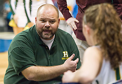 Huntington assistant coach Shawn Persinger talks with his team during a timeout against Spring Valley during a first round game at the Charleston Civic Center.