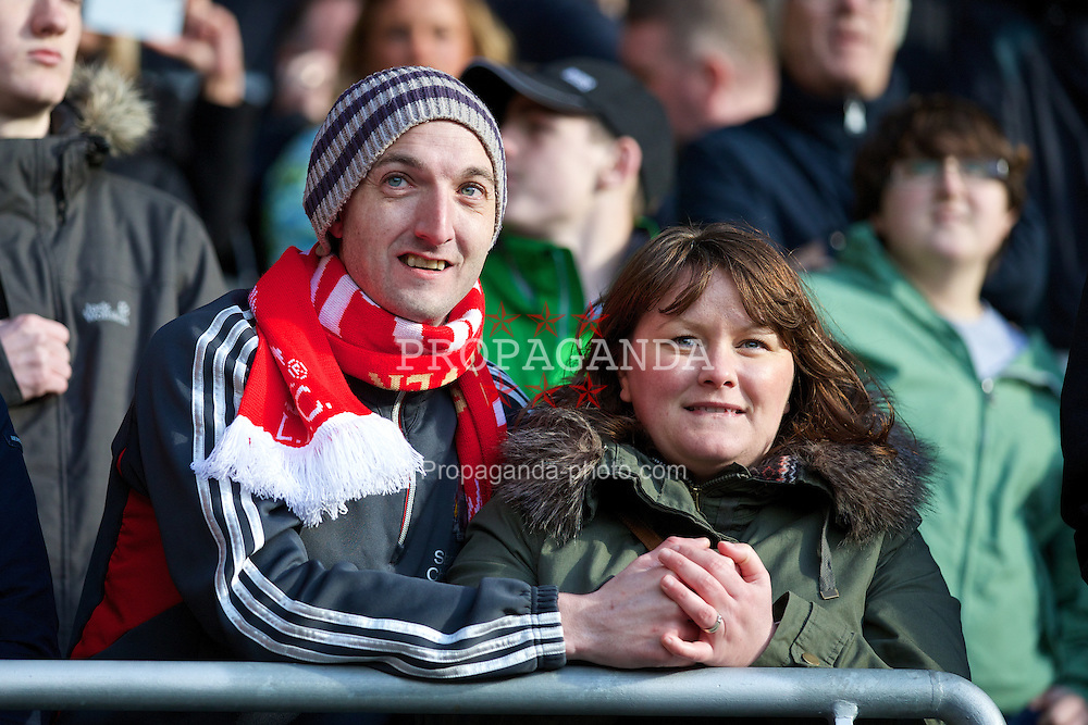 CARDIFF, WALES - Saturday, March 22, 2014: Liverpool supporters celebrate during their 6-3 victory over Cardiff City during the Premiership match at the Cardiff City Stadium. (Pic by David Rawcliffe/Propaganda)