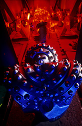 Stock photo of large oil drill bit manufacturing as it comes out of the paint coating process