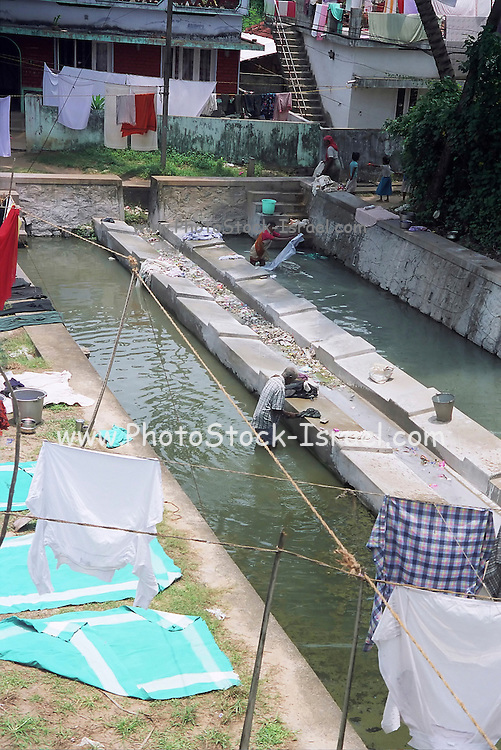 Washing day, washing and drying clothes in a river pool India, Kerala, a state on the tropical coast of south west India