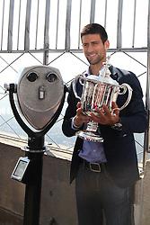 13.09.2011, Flushing Meadows, New York, USA, ATP World Tour, US Open, Finale Herren Einzel, im Bild NOVAK DJOKOVIC (SRB) mit dem Pokal für den turniersieg am Empire State Building // during ATP World Tour US Open tennis tournament final men singles at Flushing Meadows, New York, USA on 13/09/2011. EXPA Pictures © 2011, PhotoCredit: EXPA/ Newspix/ Marek Janikowski +++++ ATTENTION - FOR AUSTRIA/(AUT), SLOVENIA/(SLO), SERBIA/(SRB), CROATIA/(CRO), SWISS/(SUI) and SWEDEN/(SWE) CLIENT ONLY +++++