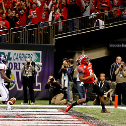 December 22, 2012; New Orleans, LA, USA; Louisiana-Lafayette Ragin Cajuns quarterback Terrance Broadway (8) celebrates in the endzone after scoring against the East Carolina Pirates during the first quarter of the New Orleans Bowl at the Mercedes-Benz Superdome. Mandatory Credit: Derick E. Hingle-USA TODAY Sports