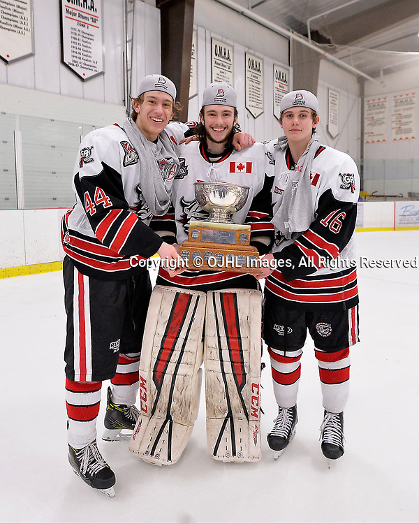 GEORGETOWN, ON  - APR 26,  2017: Ontario Junior Hockey League, Championship Series.  Georgetown Raiders vs the Trenton Golden Hawks in Game 7 of the Buckland Cup Final. Michael Vukojevic #44, Nicholas Latinovich #35 and Jack Hughes #16 of the Georgetown Raiders pose with the Buckland Cup. <br /> (Photo by Shawn Muir / OJHL Images)