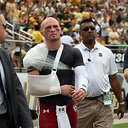 South Carolina Gamecocks quarterback Connor Shaw (14) returns to the field with an injured shoulder during an NCAA football game between the South Carolina Gamecocks and the Central Florida Knights at Bright House Networks Stadium on Saturday, September 28, 2013 in Orlando, Florida. (AP Photo/Alex Menendez)