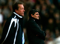 Photo: Tom Dulat/Sportsbeat Images.<br /> <br /> West Ham United v Tottenham Hotspur. The FA Barclays Premiership. 25/11/2007.<br /> <br /> Manager of West Ham United Alan Curbishley (L) and manager of Tottenham Hotspur Juande Ramos (R) during the game.