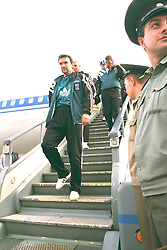 VLADIKAVKAZ, RUSSIA - Monday, September 11, 1995: Liverpool's Neil Ruddock steps off the Aeroflot plane at Vladikavkaz airport as the team arrive in Russia ahead of the UEFA Cup 1st Round 1st Leg match against FC Alania Spartak Vladikavkaz. (Photo by David Rawcliffe/Propaganda)