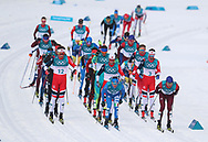Competitors come around for the second lap of the Men's 50km Mass Start Classic at the Alpensia Cross Country Centre during day fifteen of the PyeongChang 2018 Winter Olympic Games in South Korea.