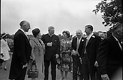 05/07/1967<br /> 07/05/1967<br /> 05 July 1967<br /> Wedding of George Walsh, eldest son of Mr and Ms Kevin G. Walsh, St. Rita's, Firhouse Road, Templeogue, Co. Dublin and Miss Arlene McMahon, elder daughter of Det. Chief Supt. Philip McMahon, Head of Special Branch, Dublin Castle and Mrs McMahon of Lisieux, Templeville Park, Templeogue, Co. Dublin who were married at the Carmelite Church, Terenure College, Dublin. An Taoiseach Mr Jack Lynch and Mrs Lynch; Mr Liam Cosgrave, leader Fine Gael and Mrs Cosgrave were among the 120 guests. Rev Fr H.E. Wright, O. Carm., Moate, officiated at the ceremony. The reception was held at Downshire Hotel, Blessington, Co. Wicklow. Image shows parents and priest at the reception.