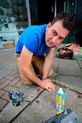 UNITED KINGDOM LONDON 14JUN07 - Environmental artist Ben Wilson sits next to the finiashed painted chewing gum picture on the pavement at Muswell Hill Broadway, north London...jre/Photo by Jiri Rezac..© Jiri Rezac 2007..Contact: +44 (0) 7050 110 417.Mobile:  +44 (0) 7801 337 683.Office:  +44 (0) 20 8968 9635..Email:   jiri@jirirezac.com.Web:    www.jirirezac.com..© All images Jiri Rezac 2007 - All rights reserved.