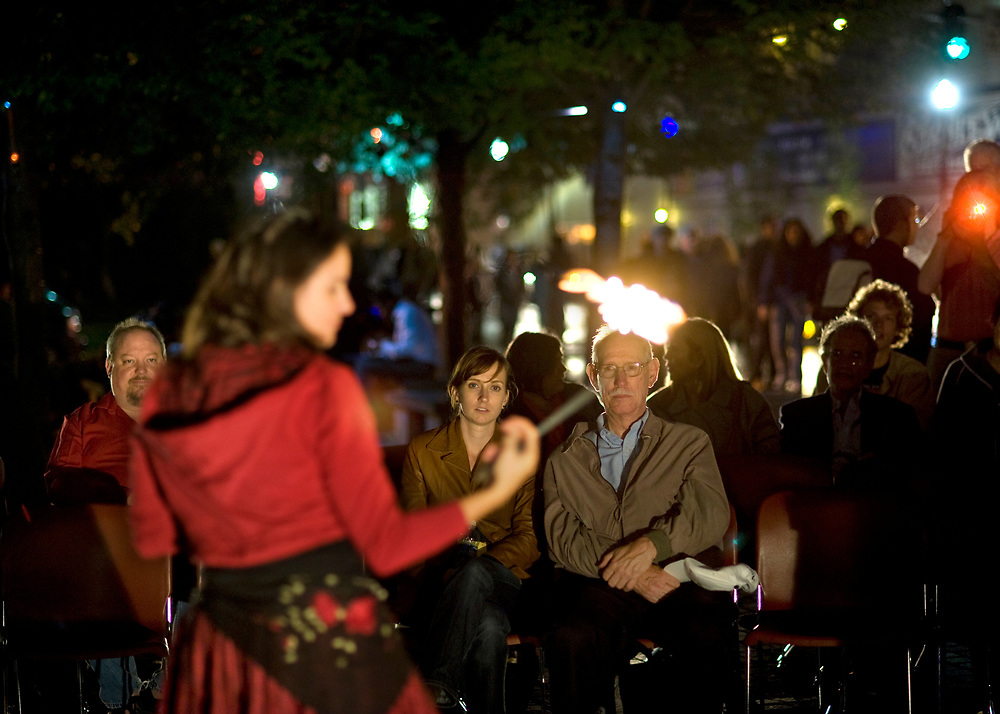 Kristin Ward, of the Middle Eastern theatrical dance group Moquette Volante, entertains attendees with fire at Katz Plaza during Pittsburgh Cultural Trust Fall Gallery Crawl in downtown Pittsburgh.