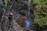 My friend, Austrian wolf biologist Gudrun Flueger climbing in Slovak Paradise National Park, Slovakia