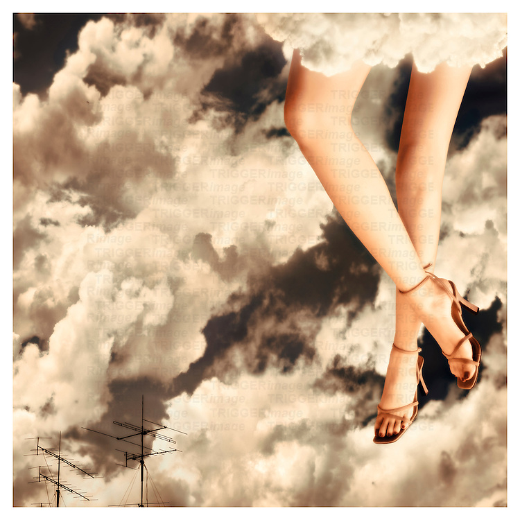 A young womans legs appearing from clouds