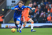 Callum Camps is fouled by Jordan Thompson during the EFL Sky Bet League 1 match between Rochdale and Blackpool at Spotland, Rochdale, England on 26 December 2018.