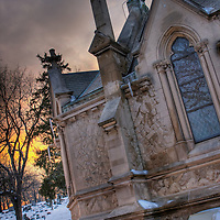 Church window at dusk in Calvary Cemetery Dayton Ohio