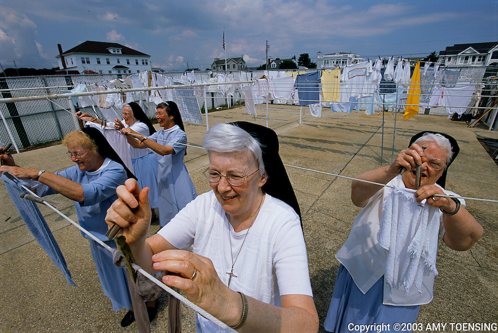 STONE HARBOR, NJ - AUGUST 19: Nuns hang their laundry while on a retreat at the Villa Maria By The Sea August 19, 2003 in Stone Harbor, New Jersey. The Jersey Shore, a 127 mile stretch of coastline known for its variety of beaches, boardwalks, small towns, natural beauty and summer crowds, has been a popular summer destination for over a century. (Photo By Amy Toensing)