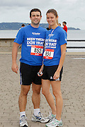 06/08/2012 No fee for Repro: Fintan Redmond from Kiliney and Megan Cronin from Stepaside are pictured warning up for the DLR Bay 10K road race. Pic Jason Clarke Photography